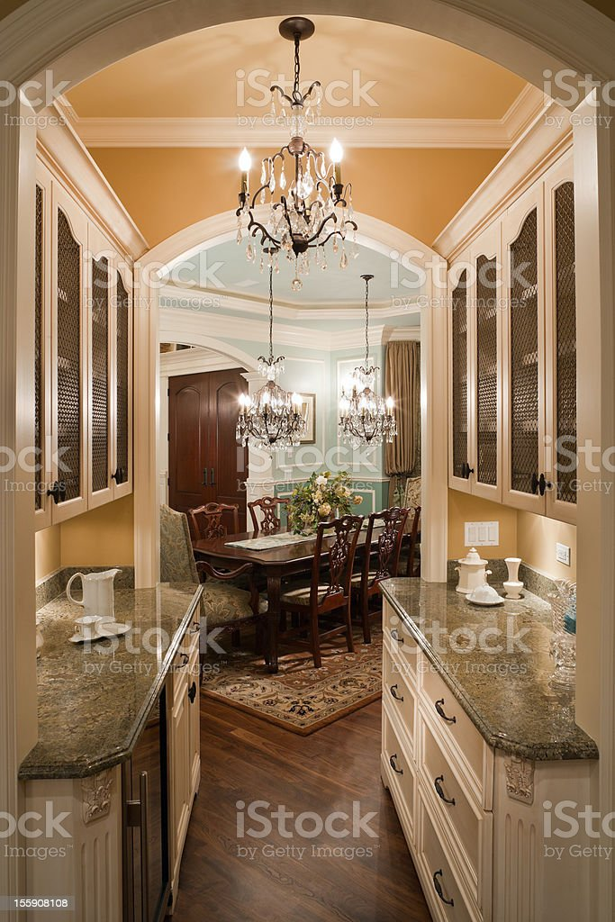 Elegant butler pantry leading to formal dining room royalty-free stock photo
