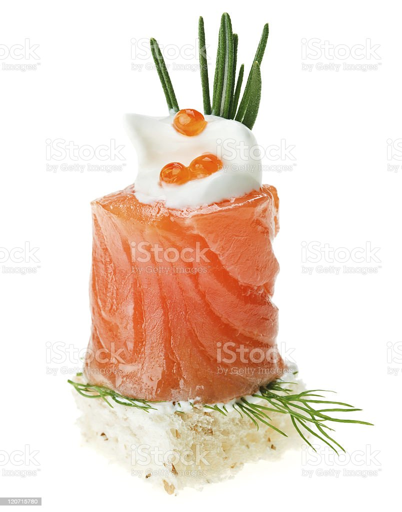 Elegant canape with salmon roll, toast, rosemary twig and caviar stock photo