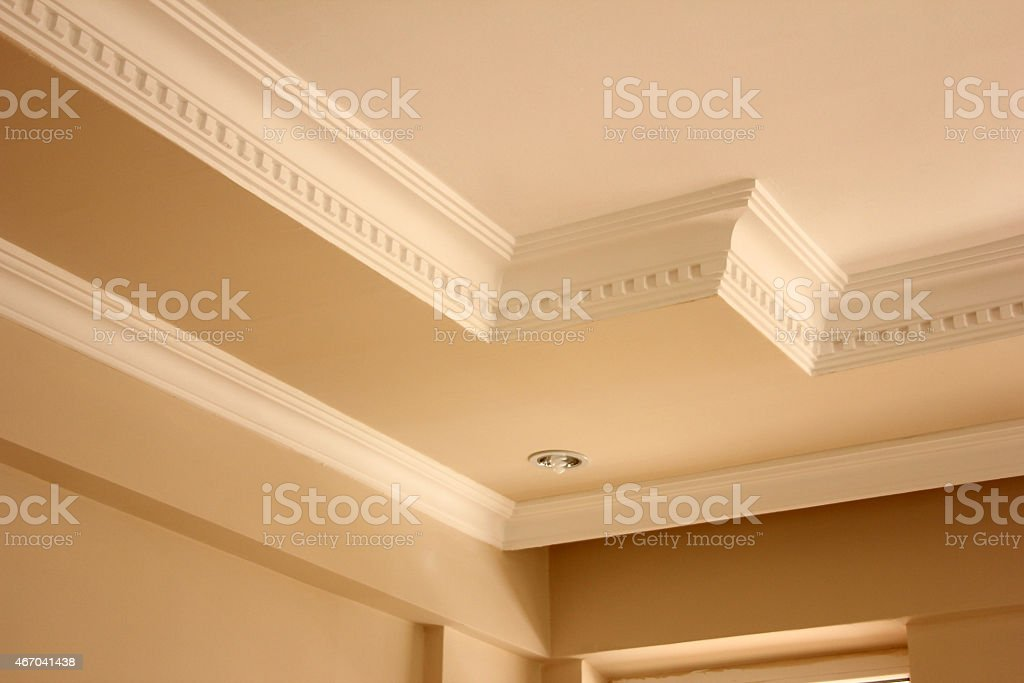 Elegant ceiling with tan and cream paint colors stock photo