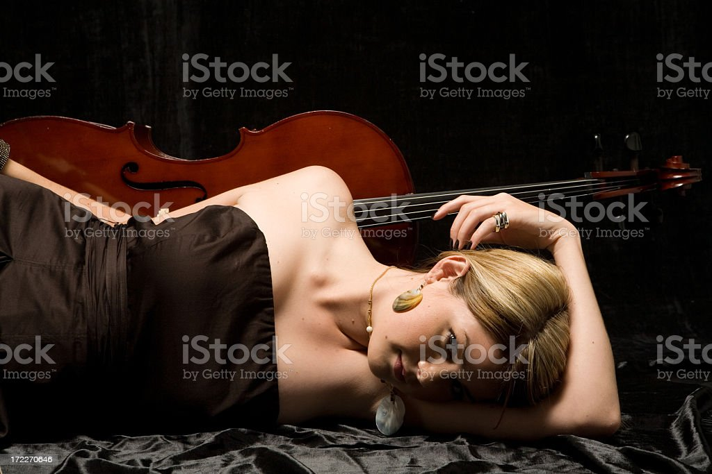 Elegant cellist relaxing stock photo