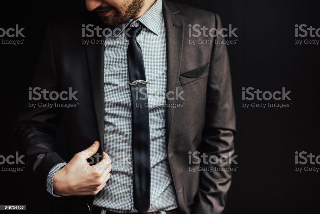 Elegant CEO on a dark background stock photo