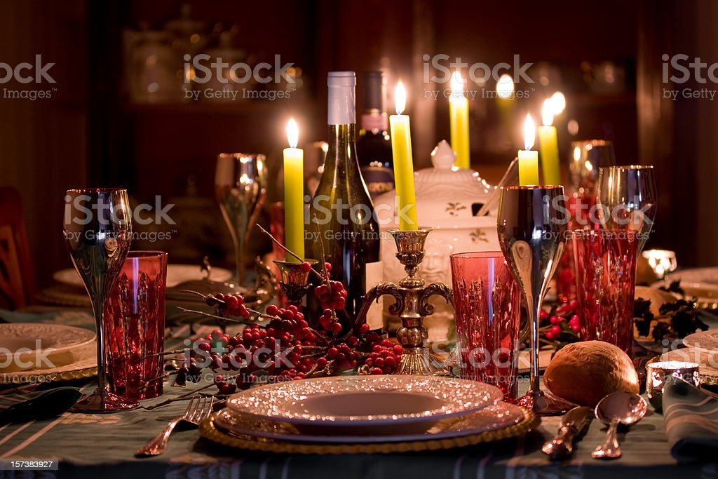 Elegant Christmas table lit by candles royalty-free stock photo