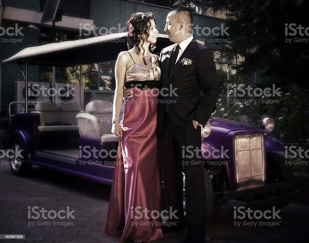 Elegant couple and old style car royalty-free stock photo