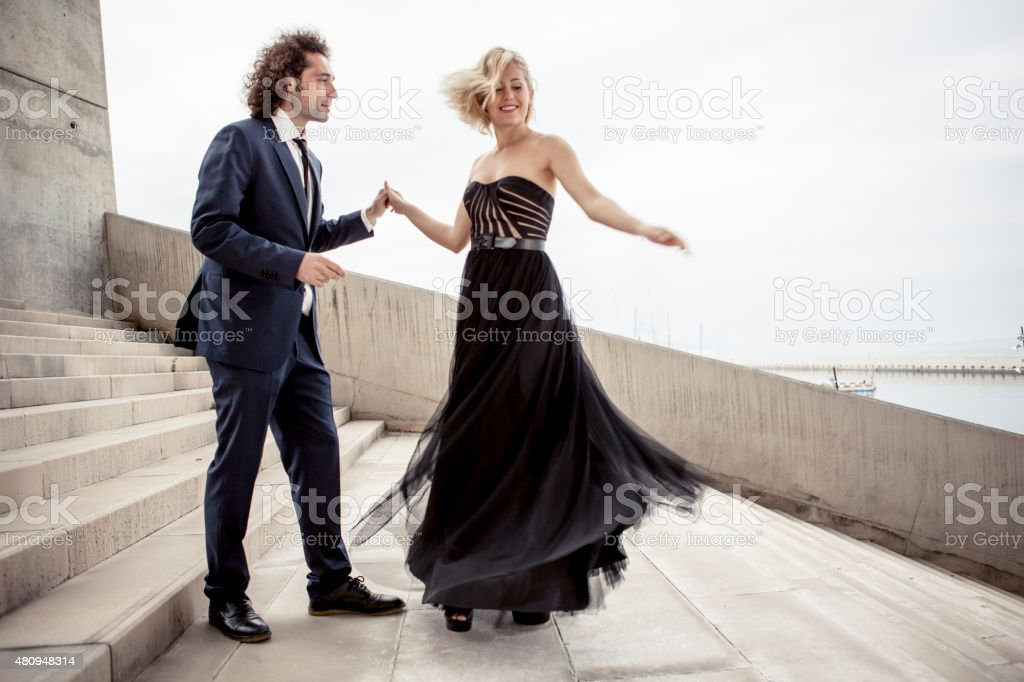 Elegant couple dancing together stock photo