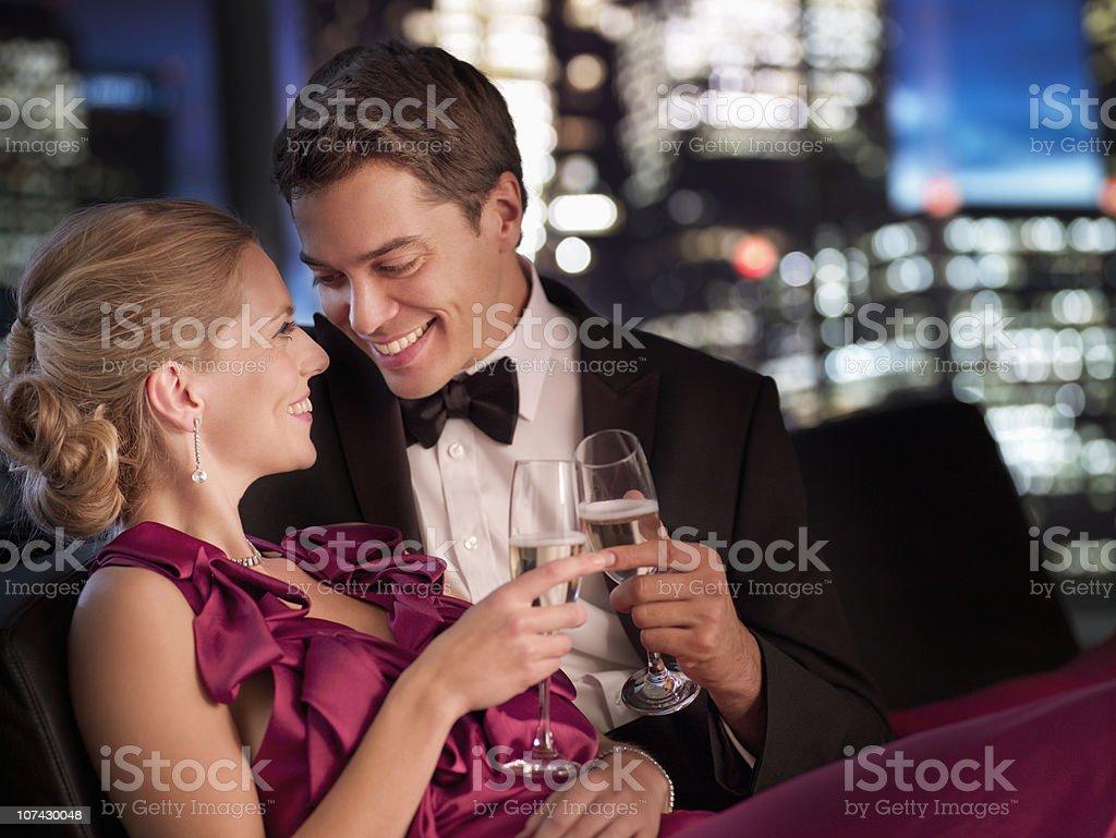 Elegant couple drinking Champagne at night royalty-free stock photo