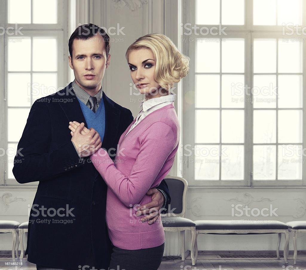 Elegant couple indoors standing near window royalty-free stock photo