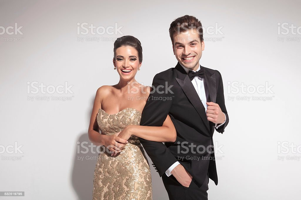 Elegant couple laughing for the camera stock photo