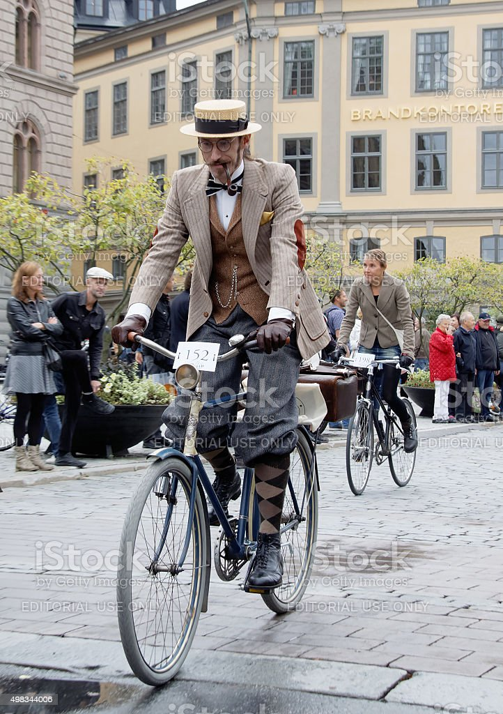 Elegant cycling man wearing old fashioned tweed clothes stock photo