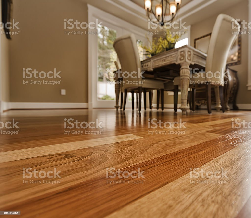 Elegant dining room table on hardwood floor stock photo