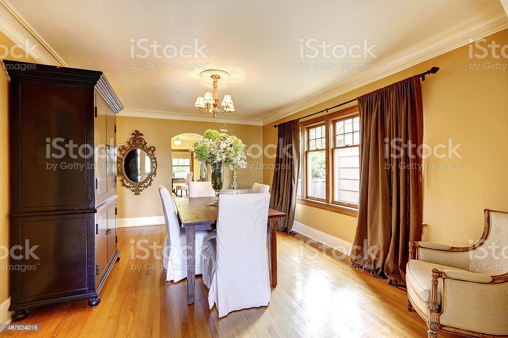 Elegant dining room with antique furniture stock photo