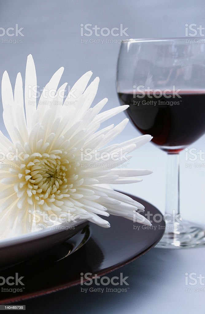 elegant dinner setting with flower and wine royalty-free stock photo