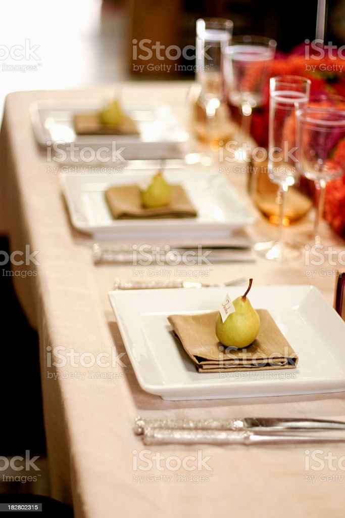 Elegant dinner table set for guests stock photo
