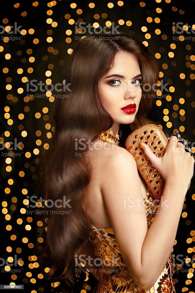 Elegant fashion brunette woman. Wavy hair style. Red lips Makeup stock photo