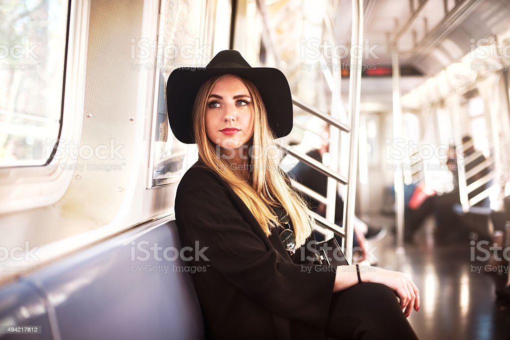 Elegant fashion business woman in the metro stock photo