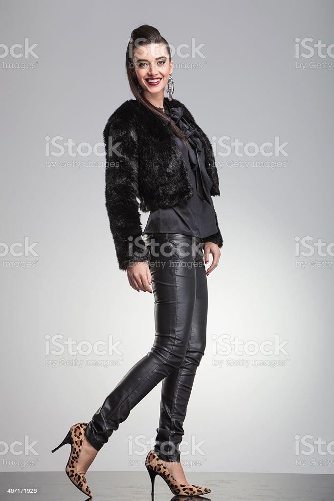 Elegant fashion woman posing with one leg to the back stock photo