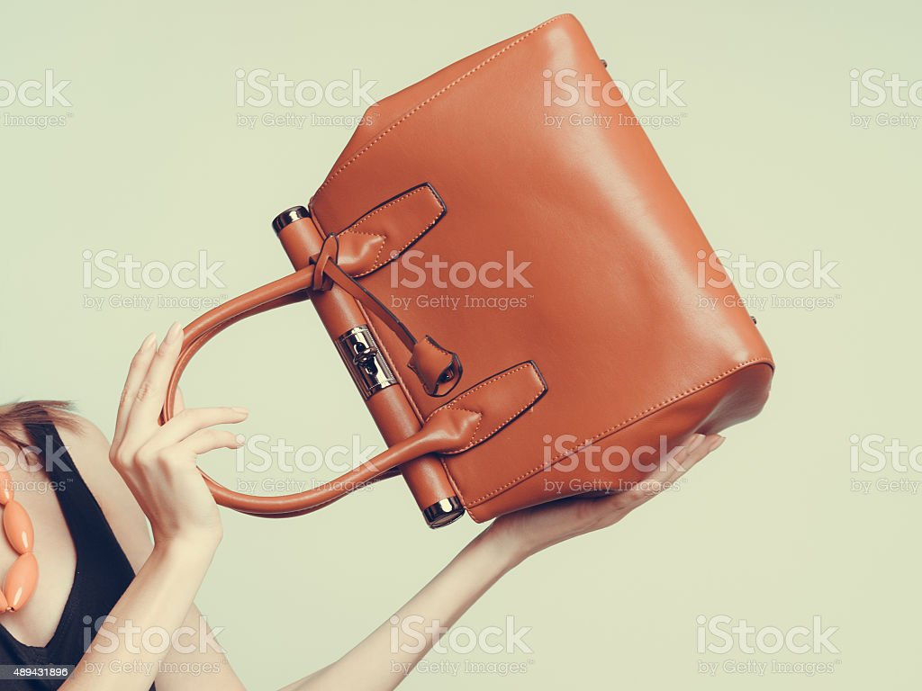 Elegant fashion woman with leather handbag stock photo