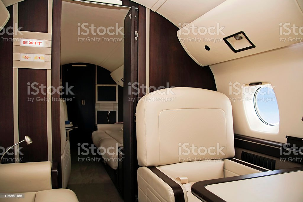 Elegant first class with white leather interior  royalty-free stock photo