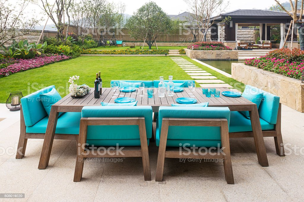 elegant furniture in the patio outside building stock photo