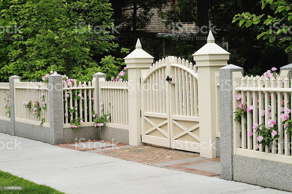 Elegant gate and fence on house entrance royalty-free stock photo
