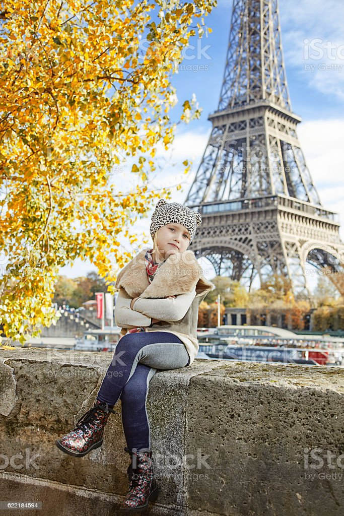 elegant girl  in Paris, France sitting on parapet stock photo