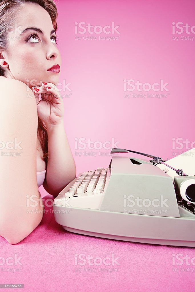 Elegant girl in pink background seeking inspiration. royalty-free stock photo