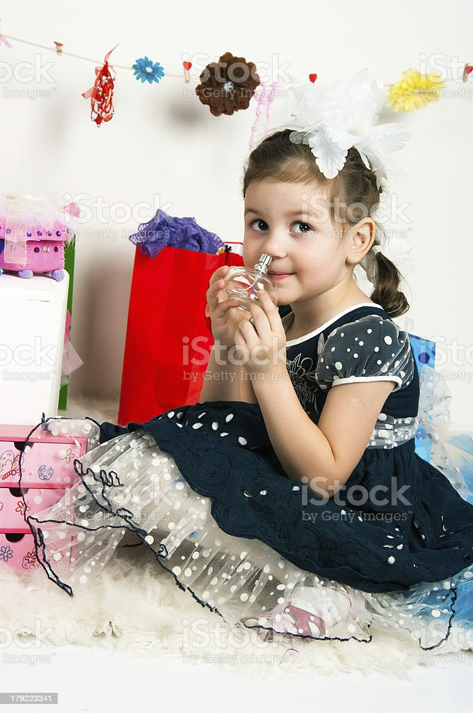 Elegant girl playing with cosmetics and jewelry royalty-free stock photo
