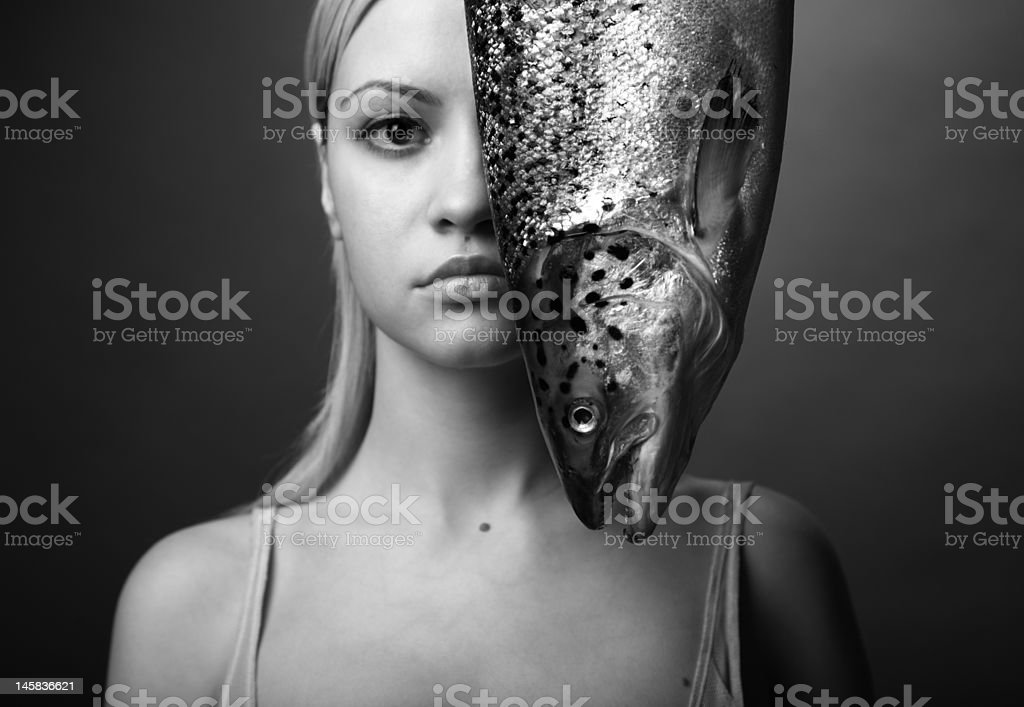 elegant girl with big fish royalty-free stock photo