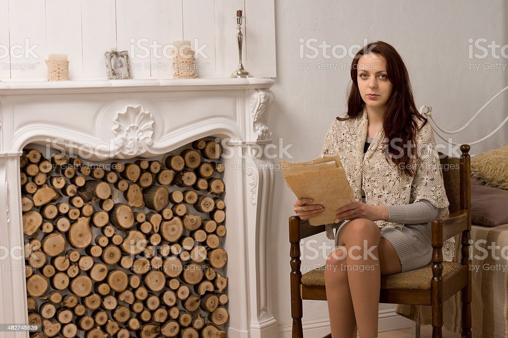 Elegant glamorous young woman in her living room royalty-free stock photo