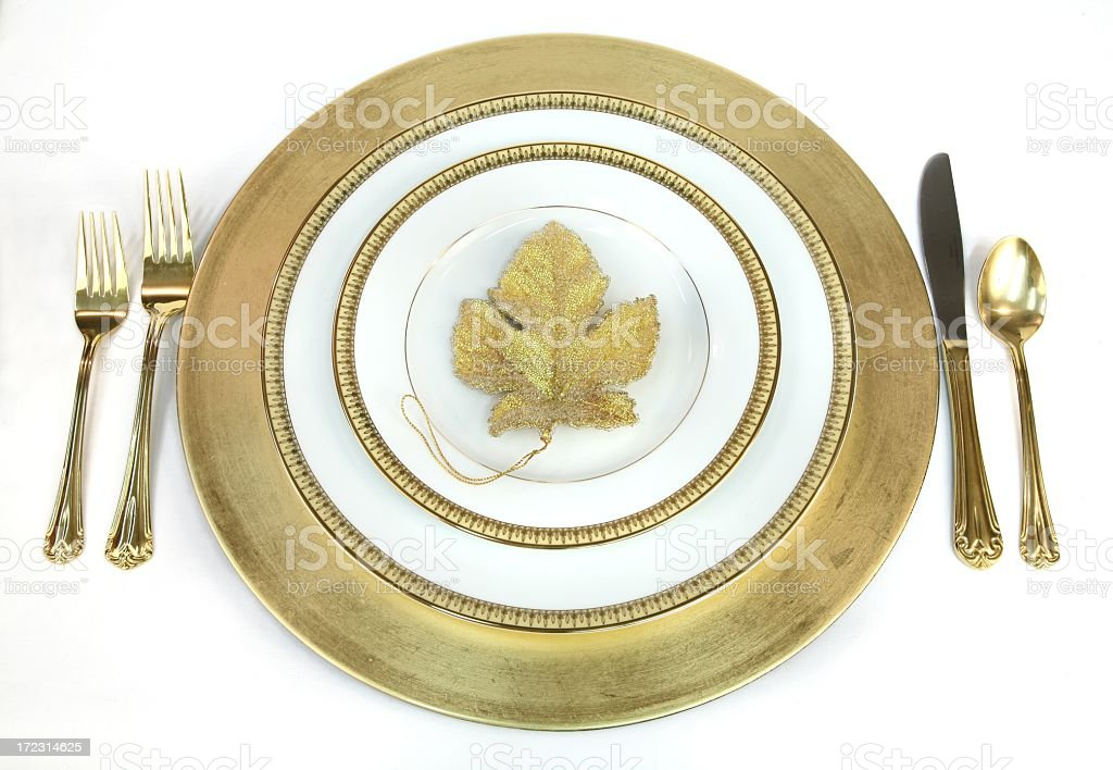 Elegant Gold and white Place Setting with leaf royalty-free stock photo