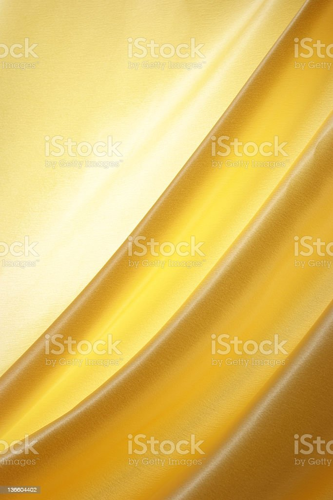 Elegant gold satin wave texture background royalty-free stock photo