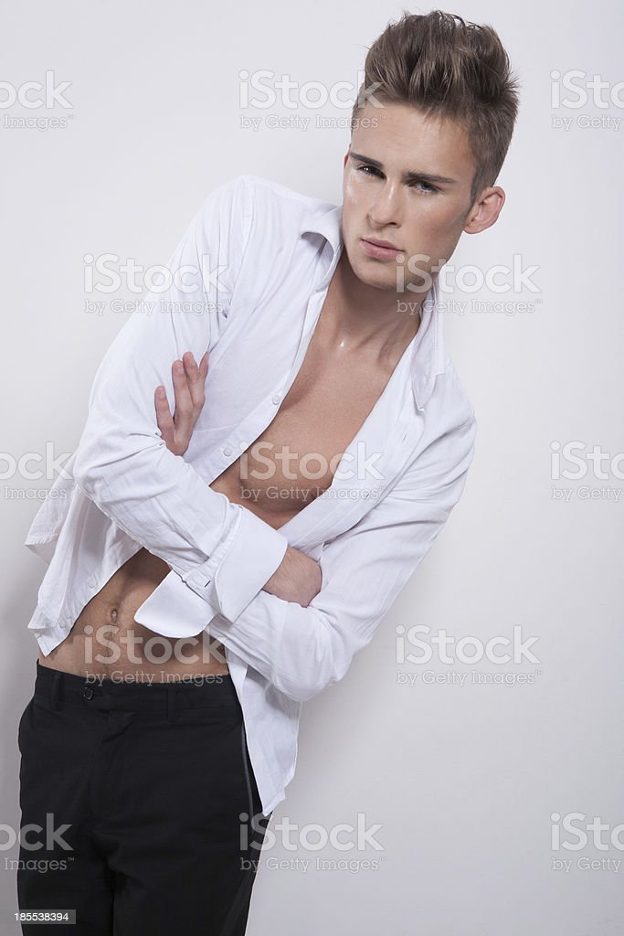 Elegant guy with crossed hands royalty-free stock photo