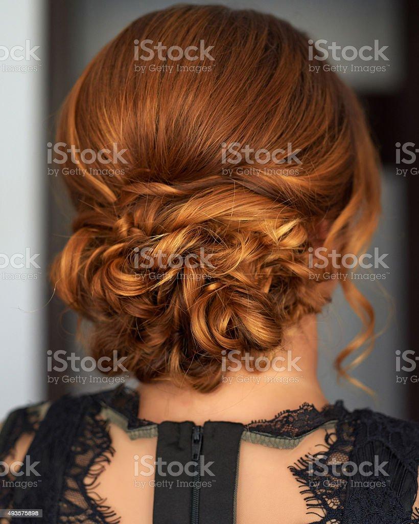 elegant hair bun stock photo