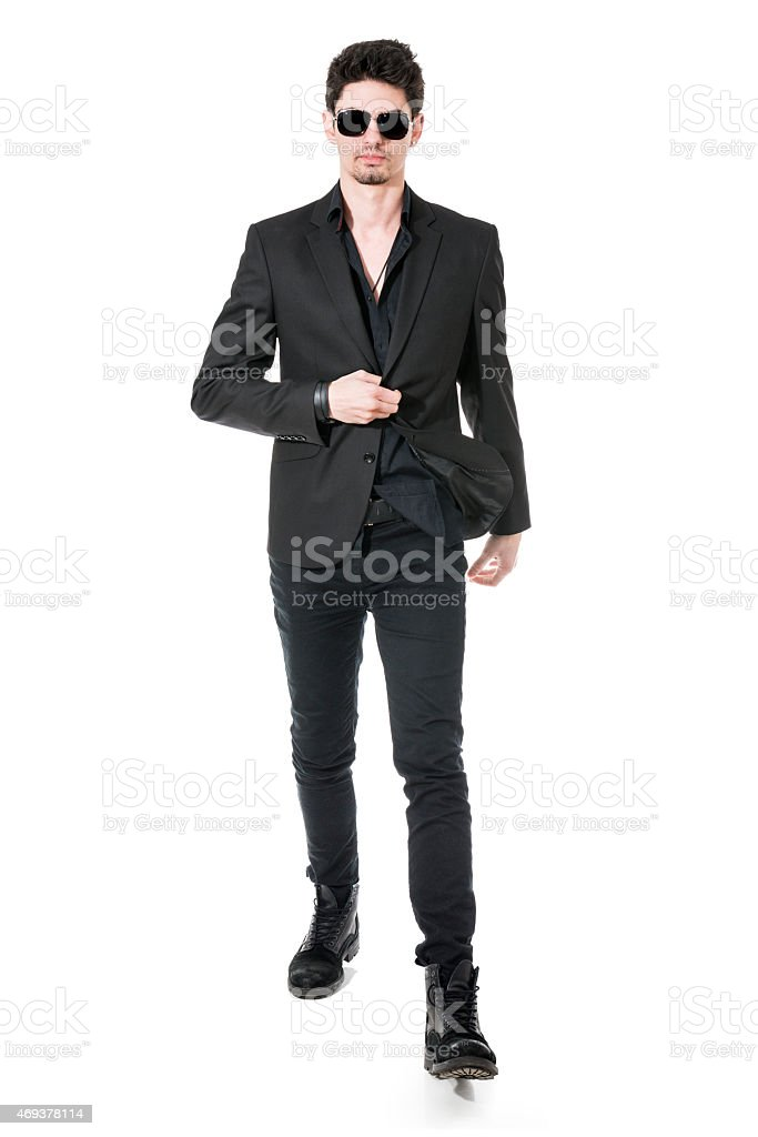 Elegant Handsome Business man with Sunglasses Walking to You stock photo