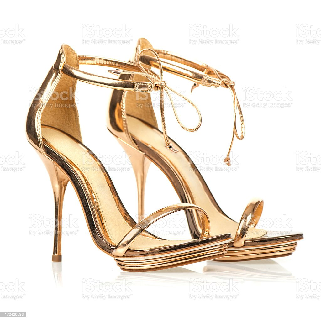 Elegant High Heels in metallic gold color with ankle straps stock photo