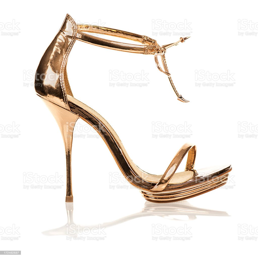 Elegant High Heels in metallic gold color with ankle straps royalty-free stock photo