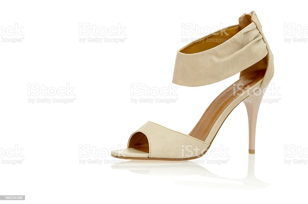 Elegant High Heels sandals with ankle strap in nude color stock photo