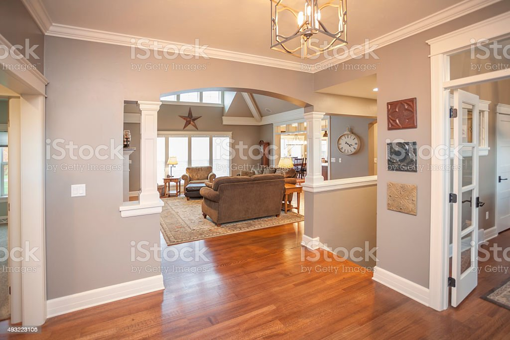 Elegant Home Foyer With Hardwood Floors stock photo