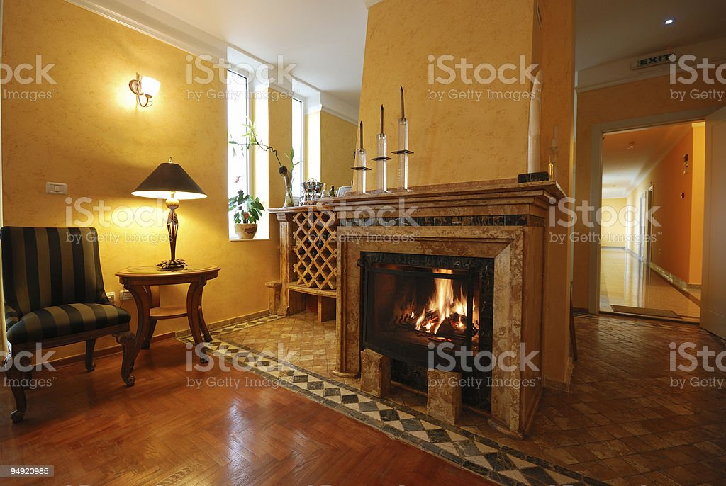 Elegant hotel apartment with a fireplace stock photo