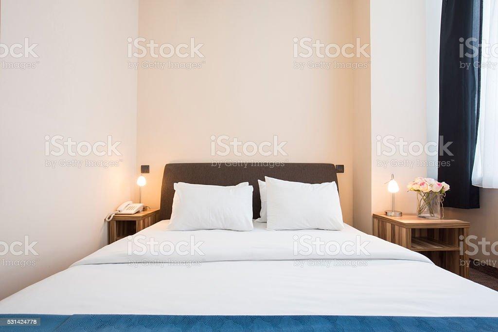 Elegant hotel bedroom interior stock photo
