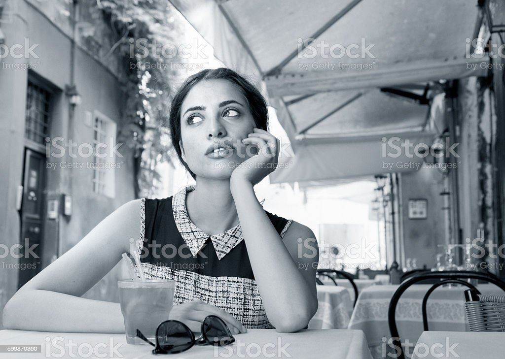 Elegant Italian girl drinking aperitif stock photo