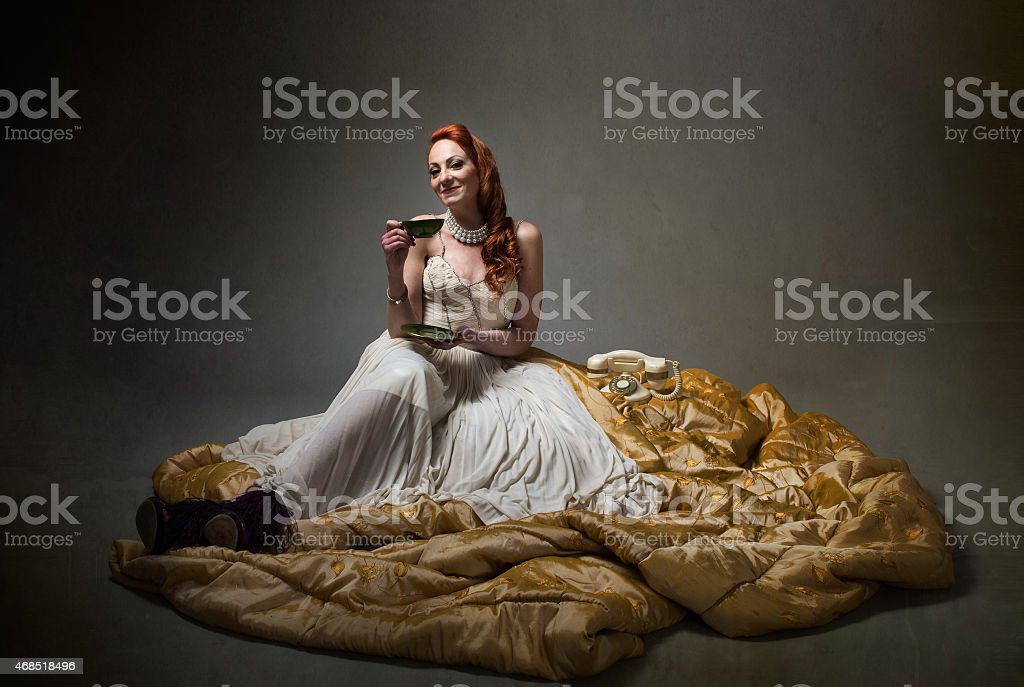 elegant lady drinking a cup of tea stock photo
