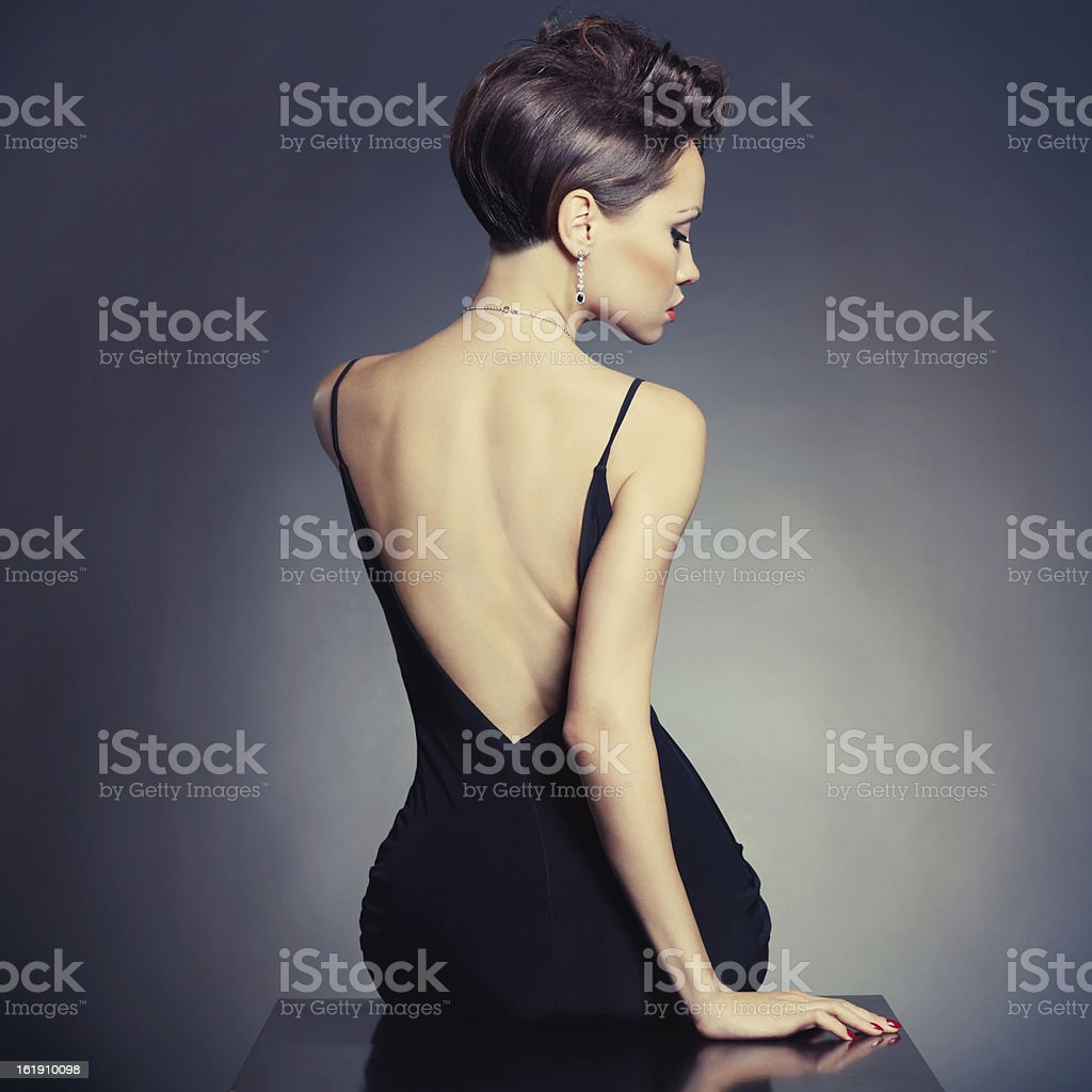 Elegant lady in evening dress stock photo