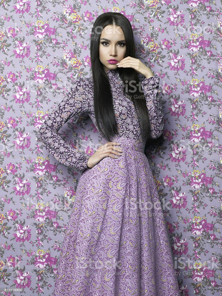 Elegant lady on floral background stock photo
