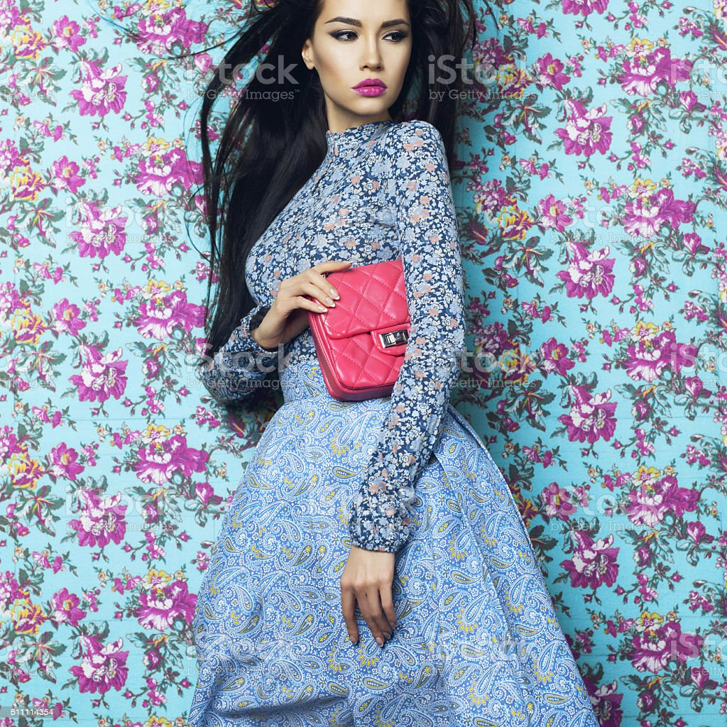Elegant lady on floral background stock photo