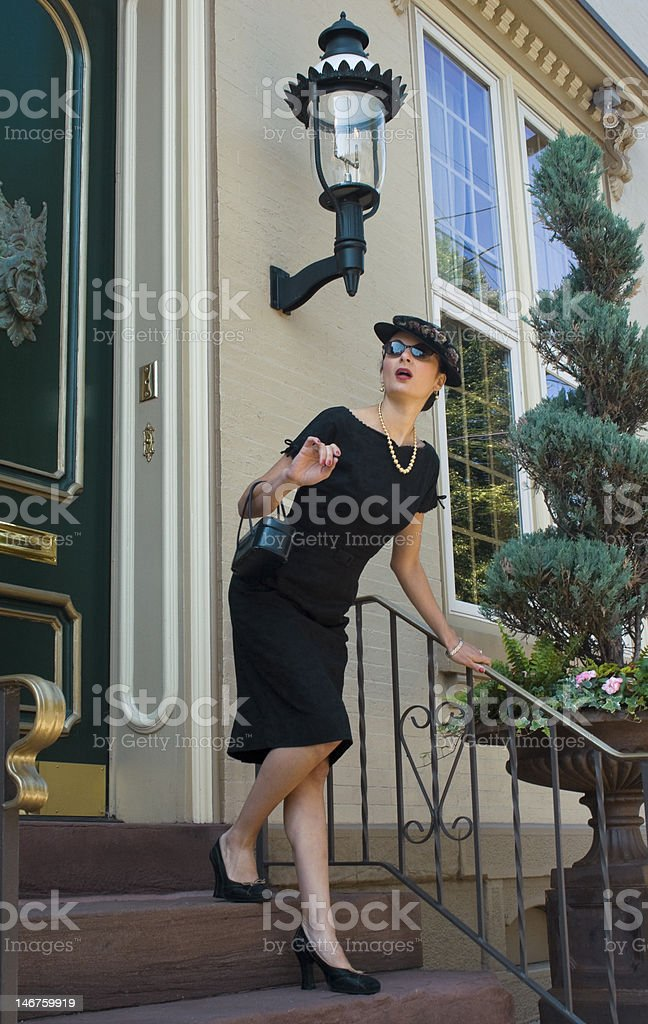 Elegant lady on steps royalty-free stock photo