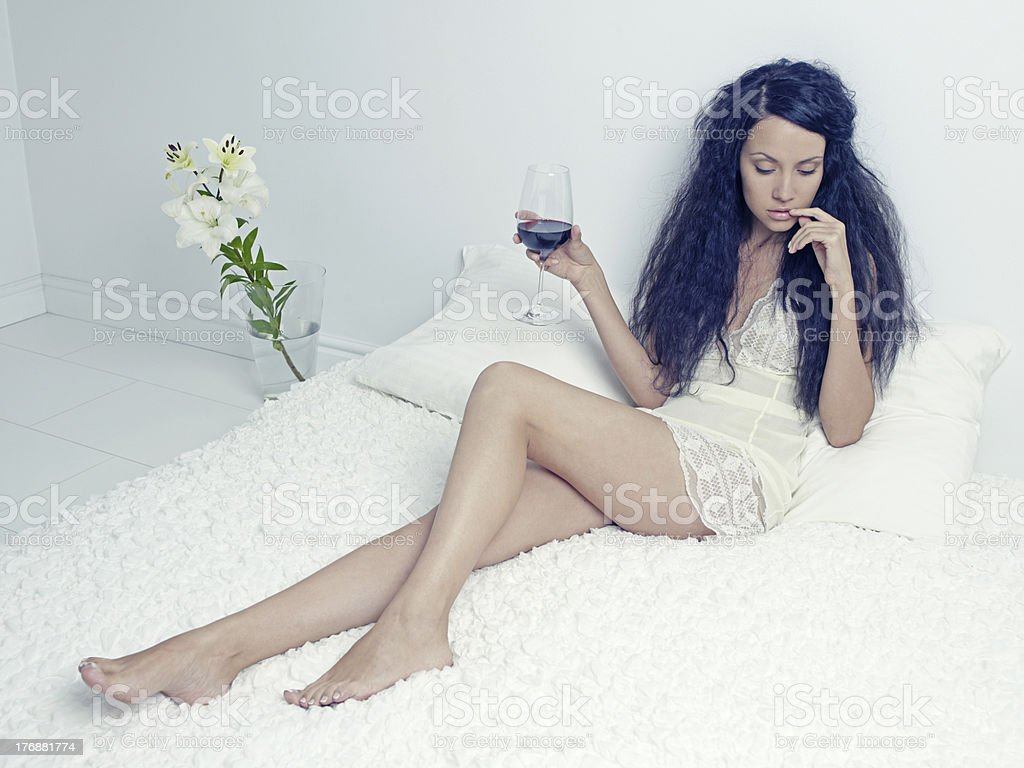 Elegant lady with a glass of wine royalty-free stock photo