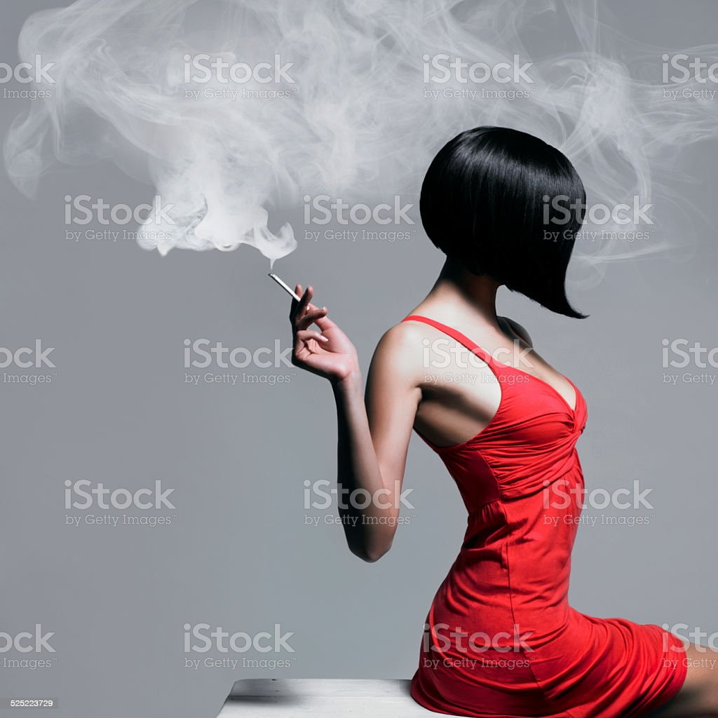 Elegant lady with cigarette stock photo