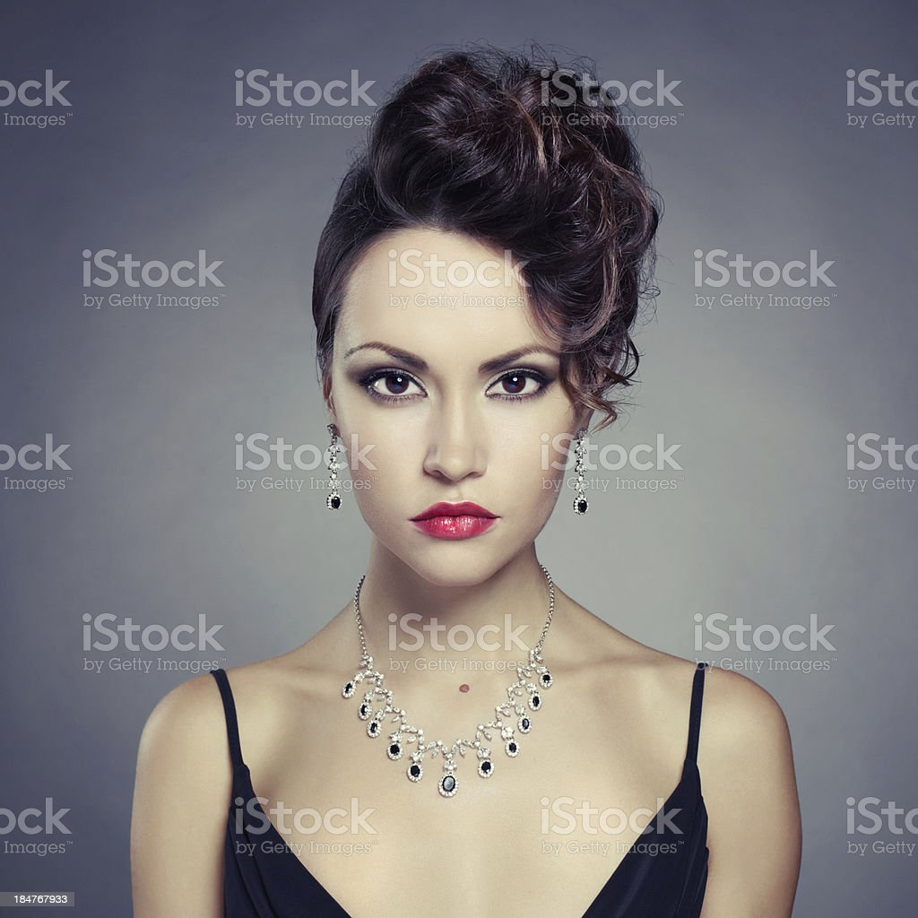 Elegant lady with red lips and black accented jewelry stock photo