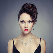 Elegant lady with red lips and black accented jewelry