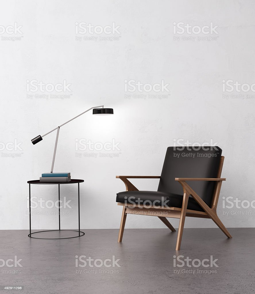 Elegant leather armchair with a side table stock photo